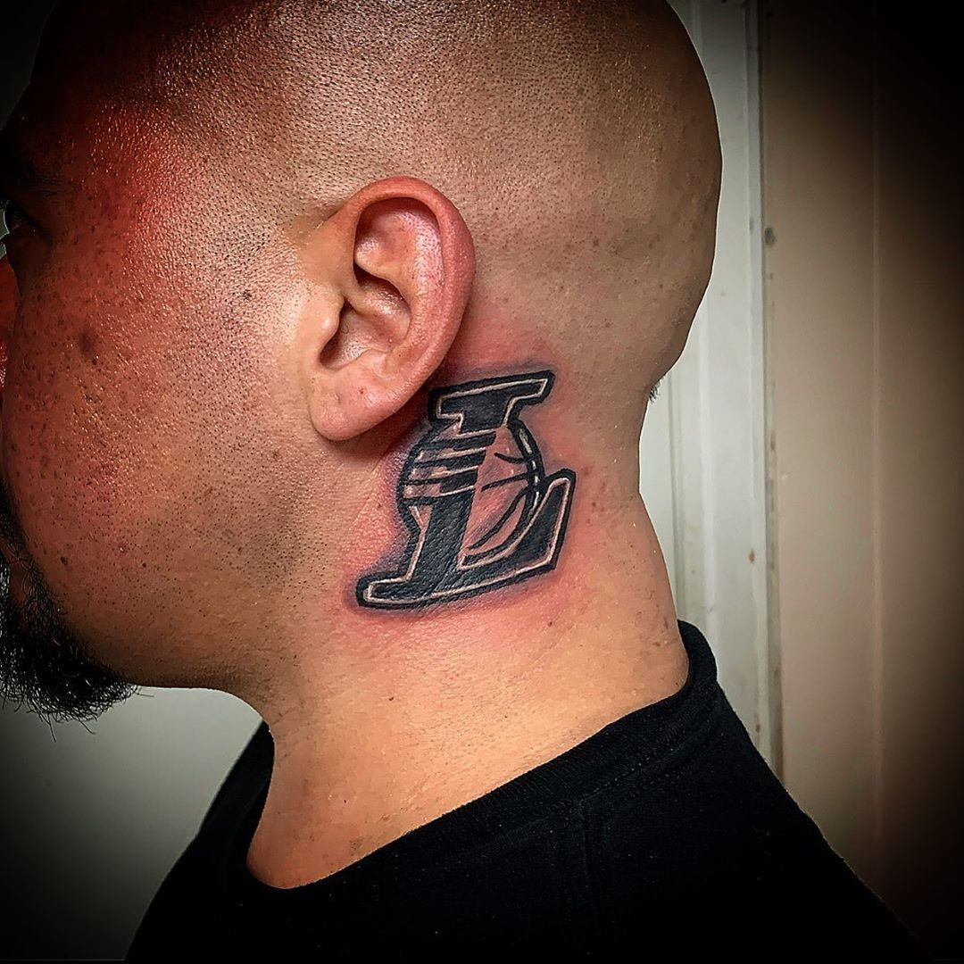 Lakers logo tattoo behind the ear