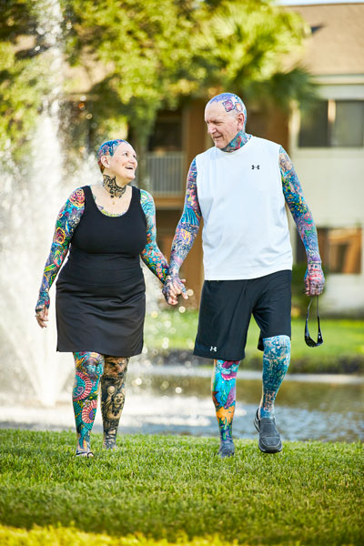 Old couple with colorful tattoo