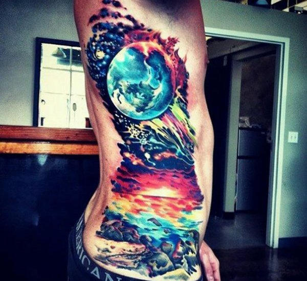 Planet tattoo on side