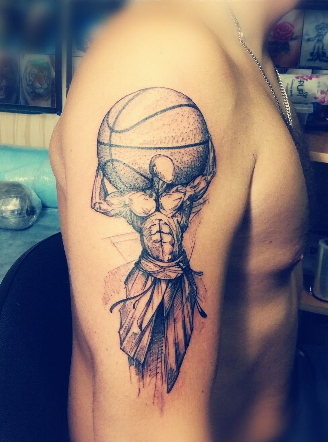 Strong man carrying basketball tattoo