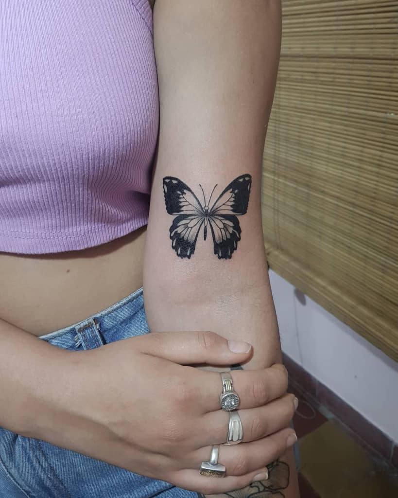 Butterfly elbow tattoo