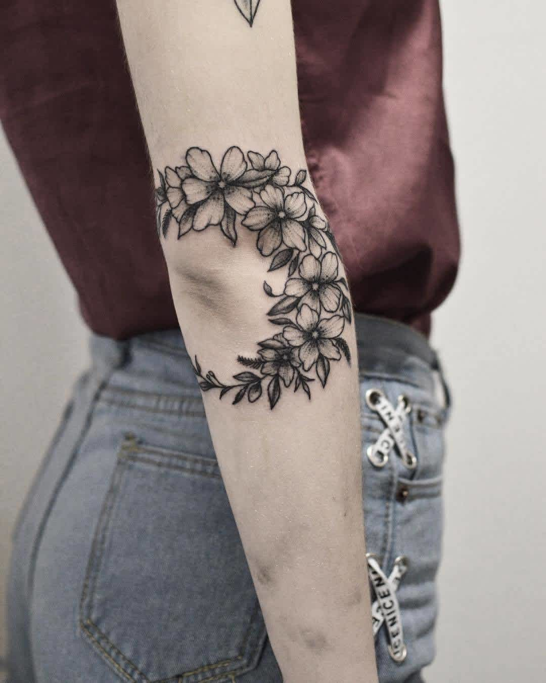 Floral crescent nature tattoo