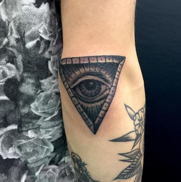Illuminati elbow tattoos