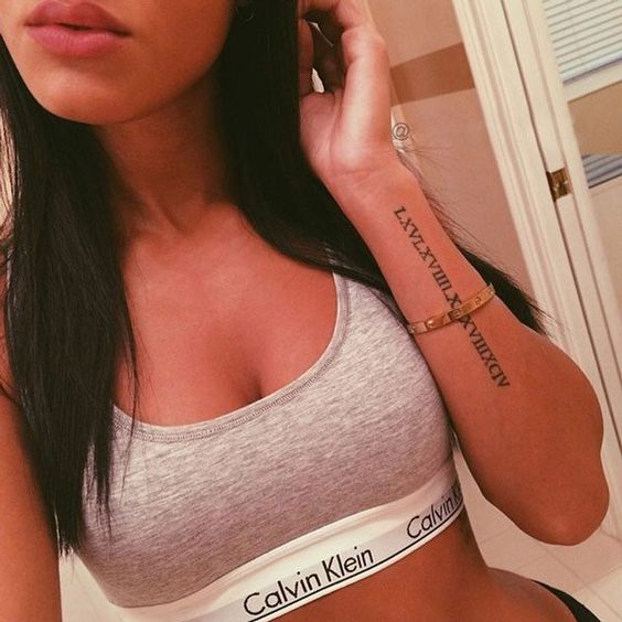Long roman numeral sign tattoo