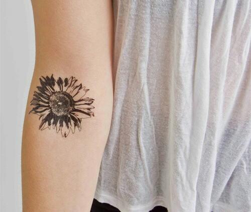 Sunflower tattoo on elbow