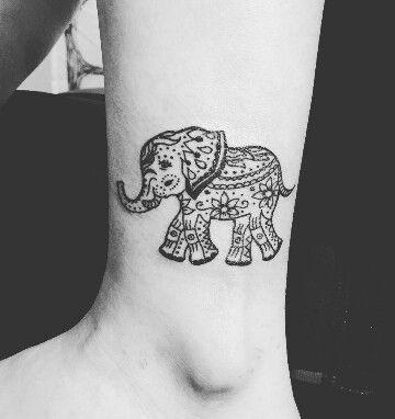 Little Ganesha tattoo on leg
