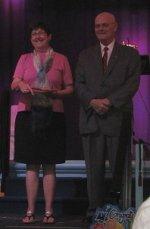 Lexi's tutor getting a certificate