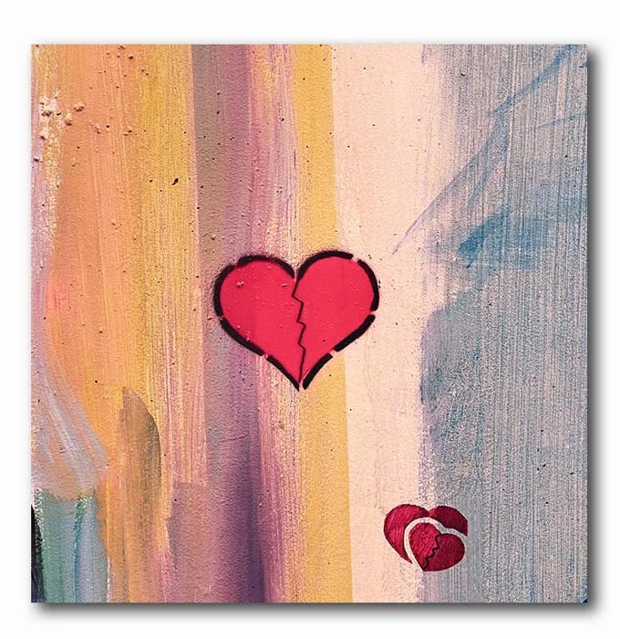 Herz Graffiti auf bunter Steinwand