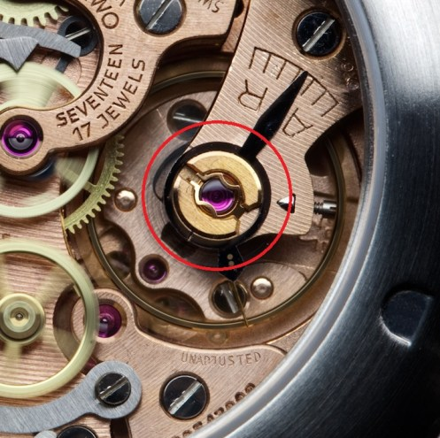 Omega 17 jewel hand-wind column wheel screwed balance chronograph movement with 30-minute and 12-hour registers.