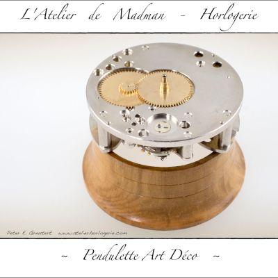 Le côté cadran, avec une roue des minutes décalée à gauche.