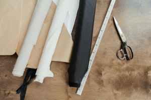 black pants on brown textile
