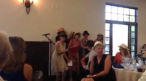 Sue in white hat (not sure if she's laughing or crying) being serenaded by us fools. Was it worth it?  Definitely.