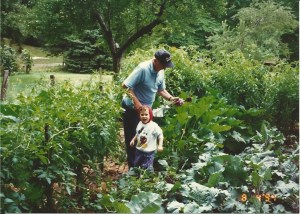 My dad tending his garden in later years (after I actually got married) The tomato plants are on the left, my son is supervising.