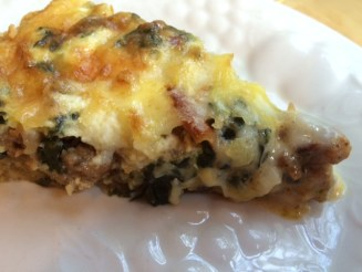 Slice of Swiss Chard, sausage quiche.
