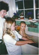 Alex helping me bathe Milena in the sink.