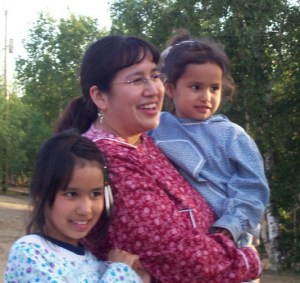 My girls and I at a potlatch in Huslia in 2007. Photo by Jo Derendoff