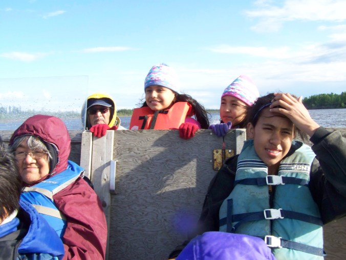Dorothy, Al Sr., Ermelina, River and Princess on a boat ride on the Koyukuk River in 2011. Photo by Angela Gonzalez