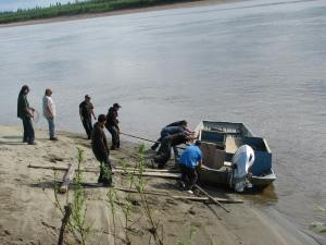 Huslia men help put my dad's boat in the water in 2011. Photo by Angela Gonzalez