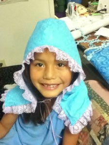 Tanya's daughter, Lydia, models a new bonnet to keep the gnats away. Photo by Tanya Yatlin