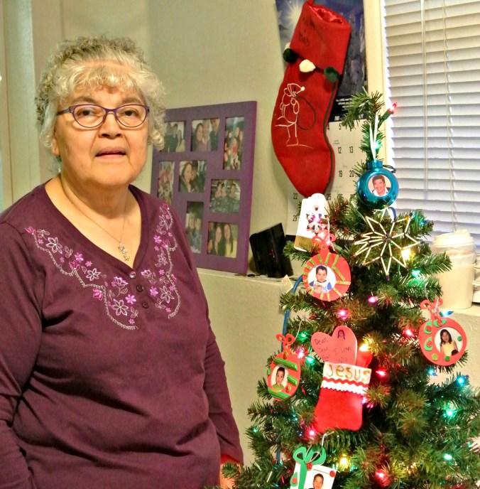 Josephine Semaken stands near her Christmas tree in Anchorage. Photo by Angela Gonzalez