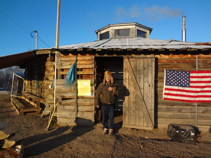 Eleanor Yatlin stands outside of the Huslia hall after voting in 2012. Photo by Georgia Attla