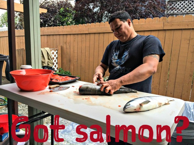Sarbelio fillets some red (sockeye) salmon in Anchorage. Photo by Angela Gonzalez