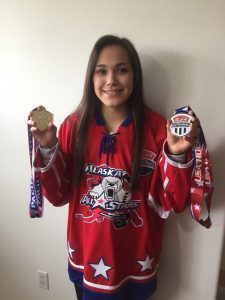 Amber Steinhilpert holds medals for first place in the Pacific District Championships in March and second place at Nationals in the Tier II U16 Girls Hockey Championships in April. Photo by Ada Chapman