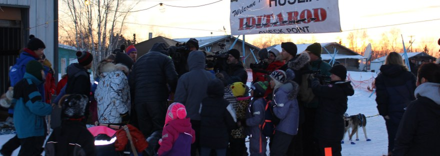 Huslia community members welcome a 2017 Iditarod musher. Photo by Angela Gonzalez