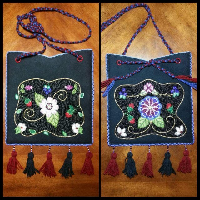 "It took Brenda Mahan nearly two years to complete this Athabascan firebag. It is 9.5"" x 10"" with a 60"" wool yarn strap which hangs approximately 30"". Brenda says, ""It is beaded on both sides and lined with cotton fabric. I utilized size 11 Japanese seed beads and it is edged with size 6 Japanese seed beads. I utilized black wool broadcloth to create the piece. On each side, there is a main flower in the center. These flowers are old patterns that I attempted to re-create. Although the overall design is my original, I referenced Northern Athabascan Art, A Beadwork Tradition by Kate C. Duncan to design my piece and to determine what was used to create a firebag."" Courtesy photo"