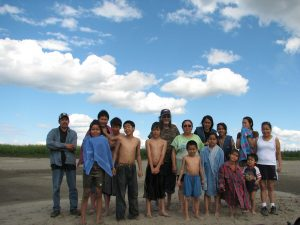 Family gathered for a swim on Lydz' beach down river from Huslia. Photo by Angela Gonzalez