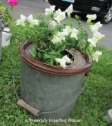 Vintage Rusted Minnow Bucket with flowers (Sprayed with a Poly Finish)