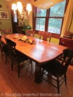 Our fantastic wood table and repurposed chairs