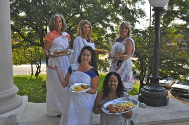 Athens Grease Festival organizers pose with fried delights at the historic Limestone County Courthouse in downtown Athens. Back row from left, Betsy Hyman, Christy Hubbard and Trisha Black. Front row from left, Holly Hollman and Letisha Brinkley. (The Huntsville Times/courtesy photo)