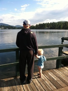 FitOldDog, with his grandson, after completing the 2011 Lake Placid Ironman with his AAA stent graft.