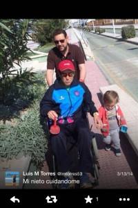 Luis M Torres in wheel chair after bike wreck.