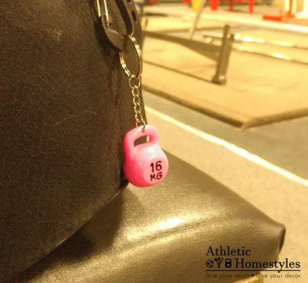 kettlebell keychain on gym bag pink