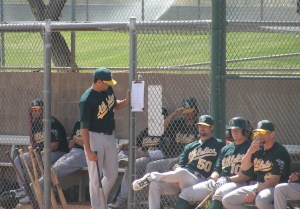 Players and coaches hanging out in and around the dugout during Saturday's Double-A game at Papago Park