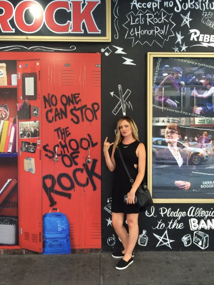 Alisha in front of the School of Rock