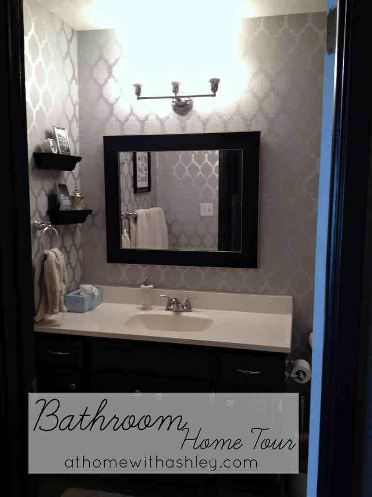 bathroom home tour. My small bathroom decor how it is now- vanity, mirror, floor, toilet, bathtub, shower curtain, and grey paint color