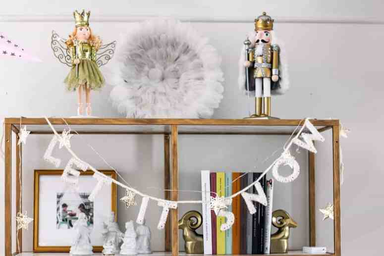 gold bookcase IKEA hack. DIY gold and marble Vitsjo shelves. Redo a $79 bookshelf into the piece of your dreams. Click through for the tutorial for this clever idea