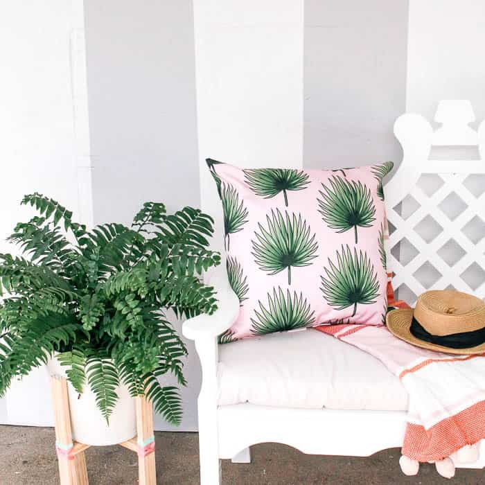 how to paint perfect stripes on a wall. Simple tips for preventing bleeds, using painters tape. How to make a cute grey vertical striped wall. #gray #stripes
