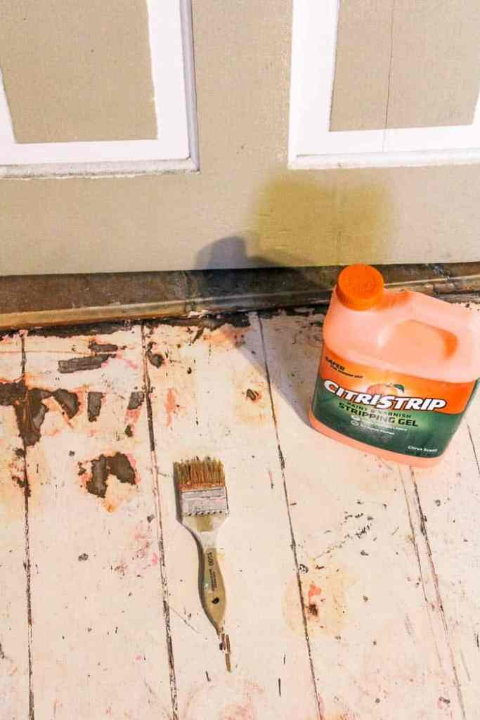 how to remove paint from wood floors. A diy tutorial with tips for how to make your floors gorgeous even if they've had paint on them. Click through for easy and simple steps
