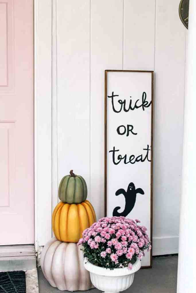 spooky and sweet Halloween porch. Are you looking for DIY ideas to make your porch awesome and scary this fall? I share the decorations I used- like a witch, skeleton, and raven and how I made a cute trick or treat sign. Your little ones will love this!