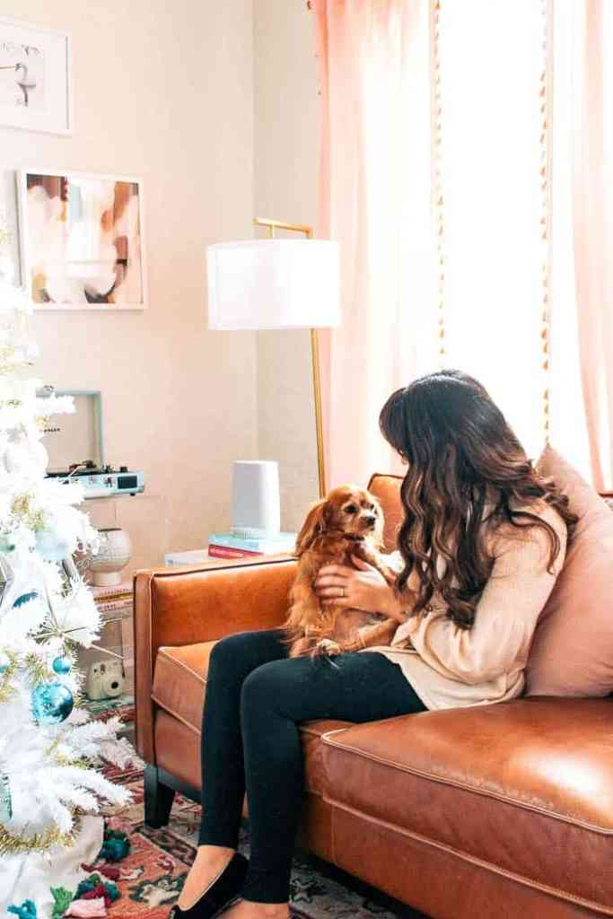 Winter Eclectic Home tour 2018. Looking for a new theme for your Christmas tree? I have ideas for decorations and share picture of my white flocked tree with bright ornaments, white lights, gold garland, and a tassel tree skirt. Bring on the colorful and pink decor for the holidays!