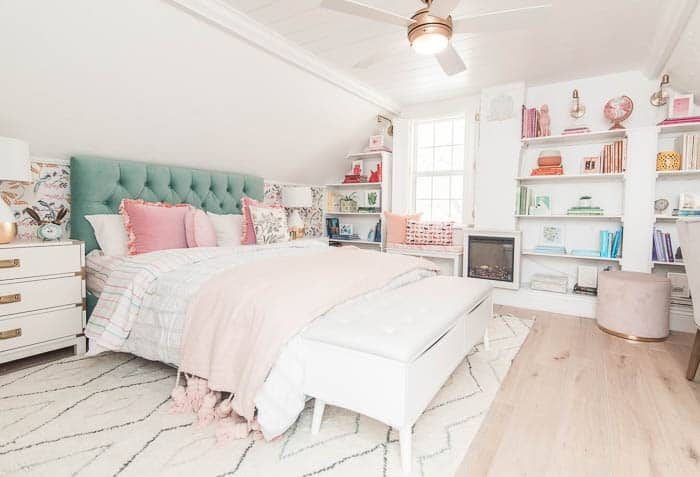 one room challenge master bedroom reveal. See the remodel and how the makeover turned out! This modern space has wallpaper and decor in lots of colors like pink, mint, and gold. White paint on the walls and boho furniture. Layered bedding ideas. This is my dream room and I hope you love it too!