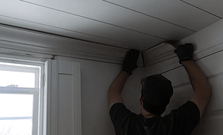 how to install crown molding. Ideas with my best tricks for how to make this easy.  You'll want to make sure to use a crown stop (or jig) to get the corners perfect. I have a video tutorial to illustrate my tips. Plus simple ways to cut crown molding for an angled ceiling. Click through for a modern before and after for crown molding in my playroom.