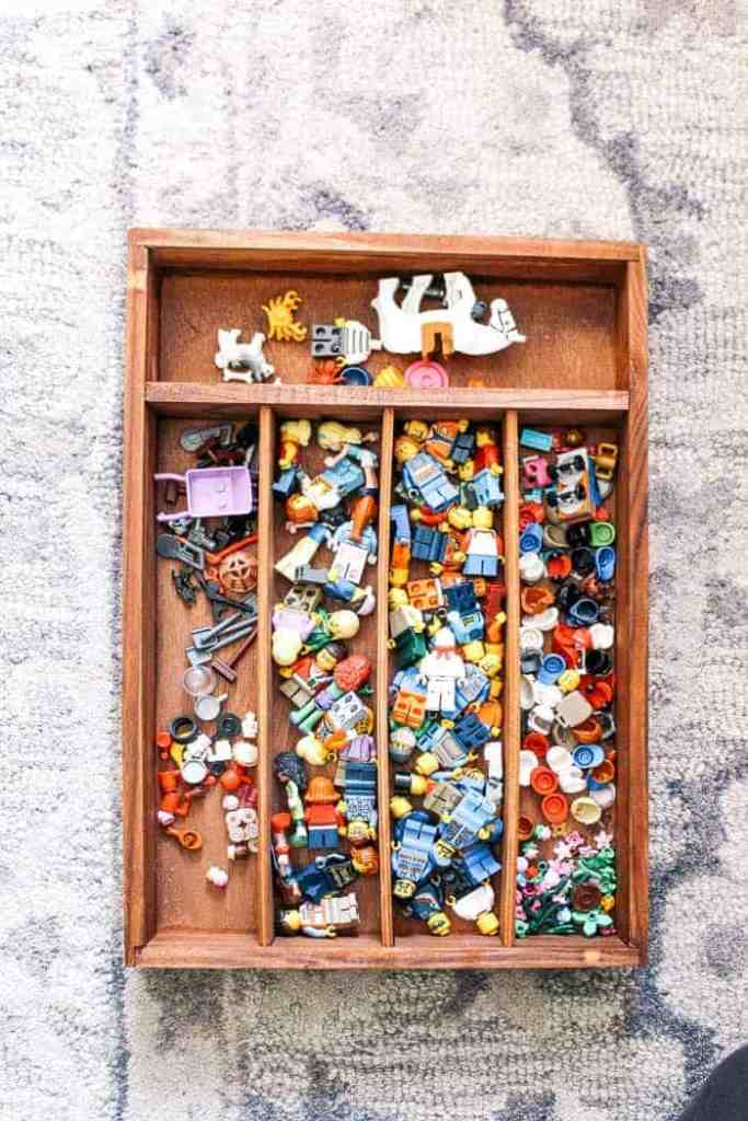 How to organize Legos. Are you sick of stepping on Legos? Does Lego storage and organization drive you crazy? Are Legos over taking your house? Learn how to organize Lego sets the easy and simple way with bin sources. Perfect for boys and girls while making it more fun for kids to build. Plus mom doesn't have to go nuts!