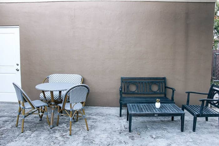 how to decorate a patio cheap- ideas. Inexpensize outdoor designs on a budget. Affordable decks and decorating diy projects and pictures of them. Backyard makeover and small spaces outside- how to add a lot of personality with plants a table, and pillows in an affordable way.