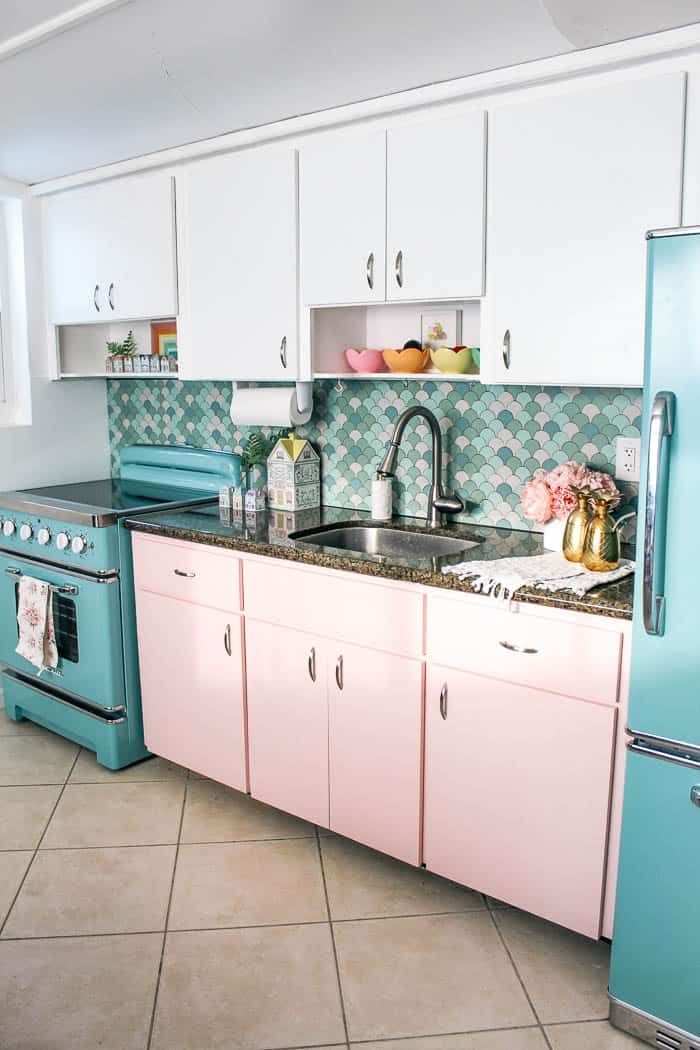 $100 kitchen update in 1 day. Ready for a budget friendly kitchen remodel and makeover?! I haves for how to paint cabinets and redo a backsplash with contact paper. This small space was done in one day- click to see the before and after