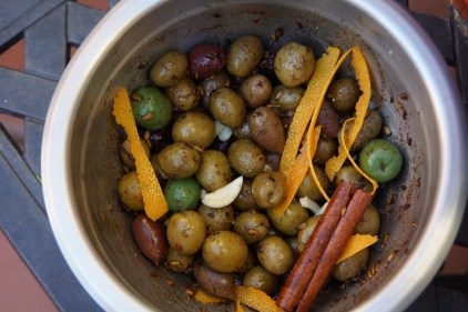 Remove pan from heat and add olives to coat. Add lemon juice, orange zest, vanilla, garlic and whole cinnamon stick.